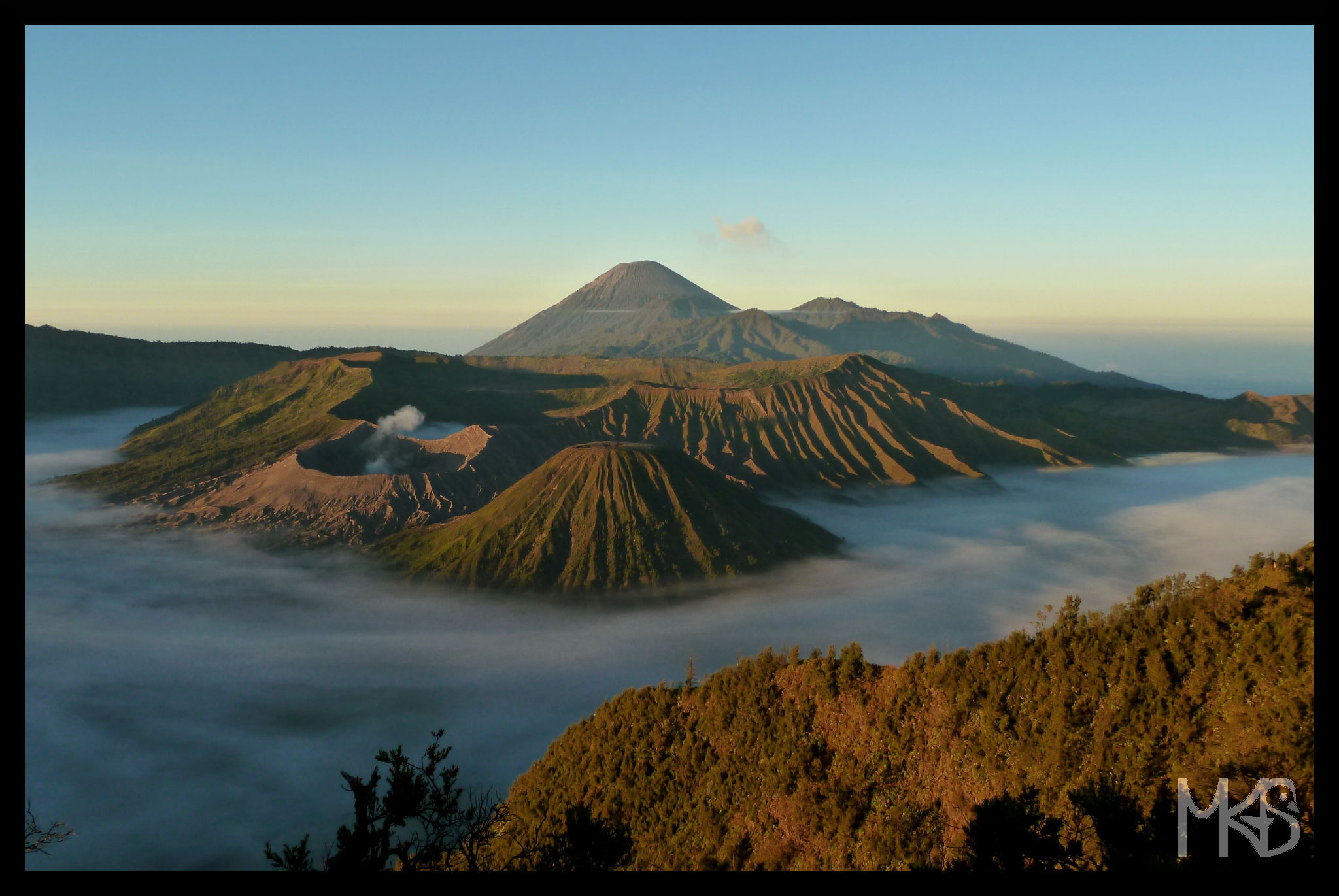 Panoramic view of Mt. Bromo (the steaming crater), Mt. Batok, Mt. Semeru (the highest).